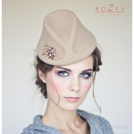 Beige cocktail hat with...