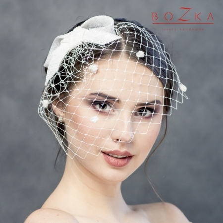 Bridal bow with dotted veil.
