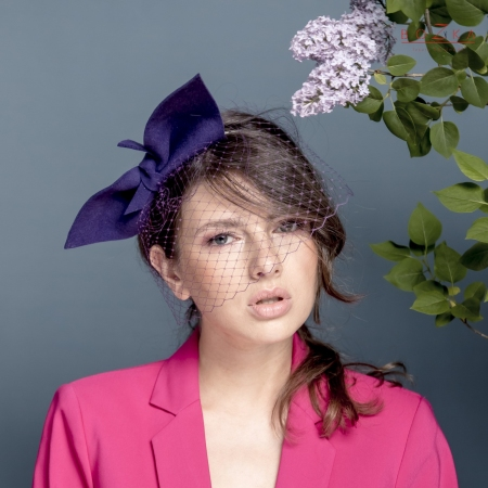 Giant purple fascinator bow.
