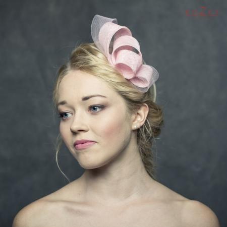 Pink fascinator with crinoline