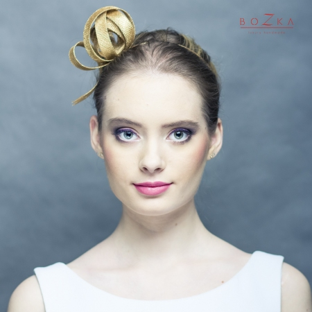 Gold hairpiece on a headband