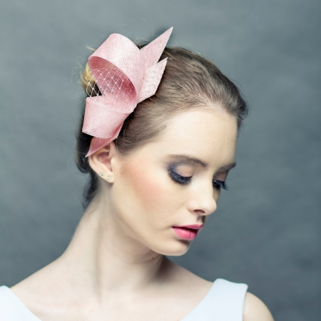 Pastel pink fascinator with...