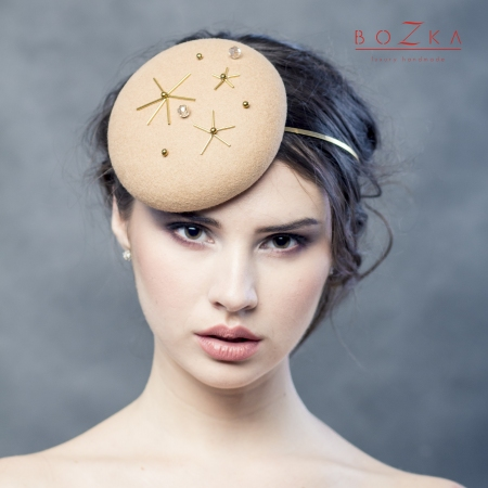 Beige pill box hat with...