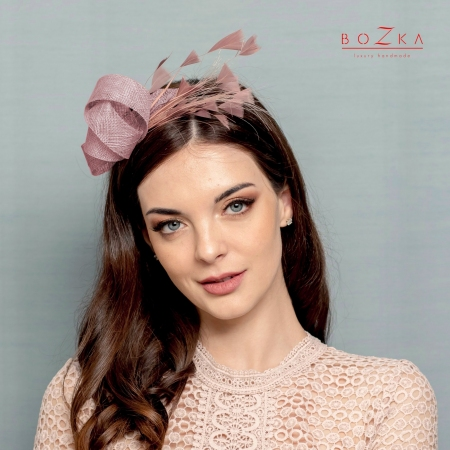 Dirty pink feather fascinator.