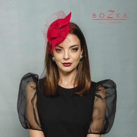 Red fascinator with veiling
