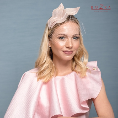 Wavy powder pink fascinator.