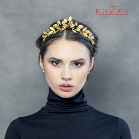 Golden tiara decorated with...