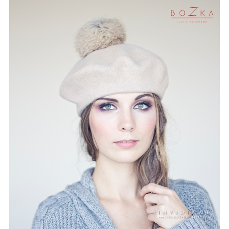 Beige beret with fur pompom